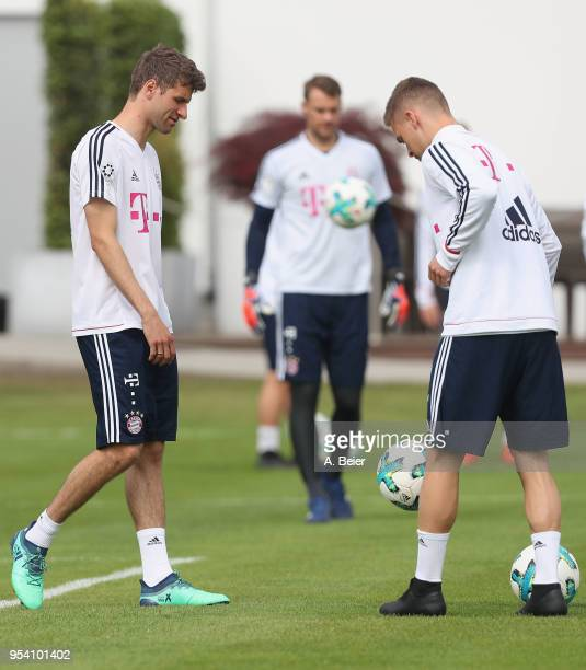 Thomas Mueller goalkeeper Manuel Neuer and Joshua Kimmich of FC Bayern Muenchen practice during a training session at the club's Saebener Strasse...