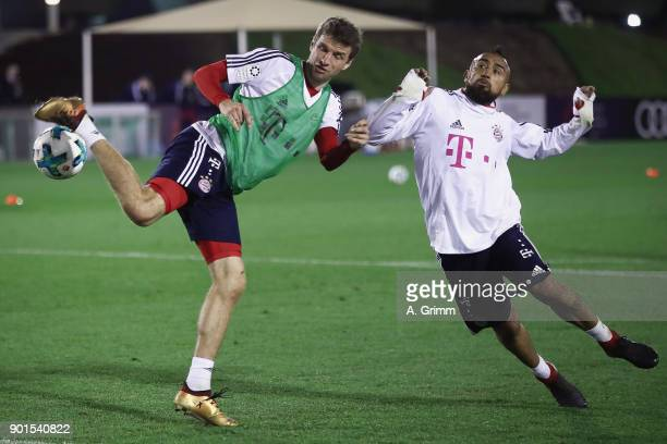 Thomas Mueller is challenged by Arturo Vidal during a training session on day 4 of the FC Bayern Muenchen training camp at ASPIRE Academy for Sports...