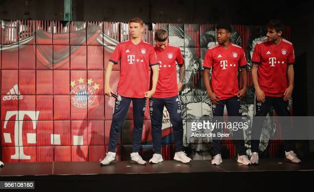 Thomas Mueller James Rodriguez David Alaba and Javi Martinez of FC Bayern Muenchen are pictured posing with their new unveiled Adidas home jersey for...