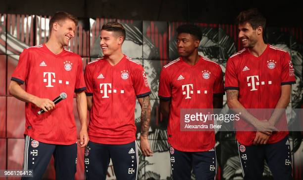 Thomas Mueller James Rodriguez David Alaba and Javi Martinez of FC Bayern Muenchen chat after they unveiled the team's Adidas home jersey for the...