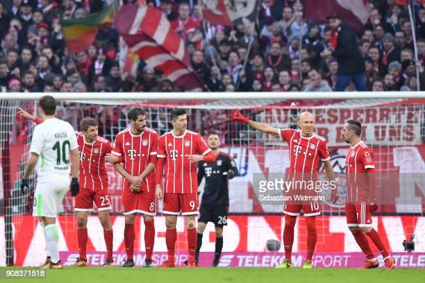 Thomas Mueller Javier Martinez Robert Lewandowski Arjen Robben and Franck Ribery of Bayern Muenchen prepare to defend against a free kick during the...