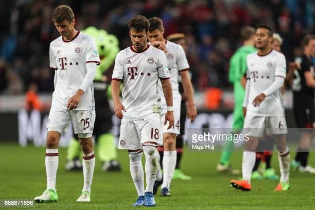 Thomas Mueller Juan Bernat and Thiago Alcantara do Nascimento of Bayern react after the Bundesliga match between Bayer 04 Leverkusen and Bayern...