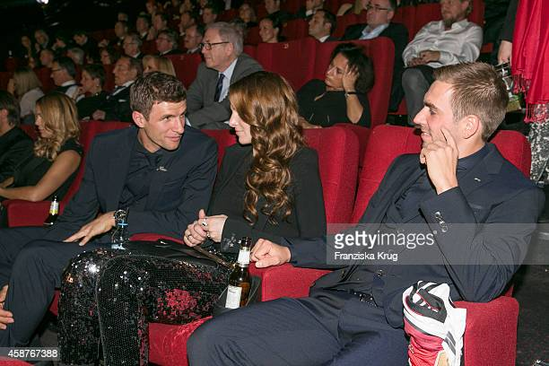 Thomas Mueller Lisa Mueller and Philipp Lahm attend the 'Die Mannschaft' Premiere at Sony Centre on November 10 2014 in Berlin Germany