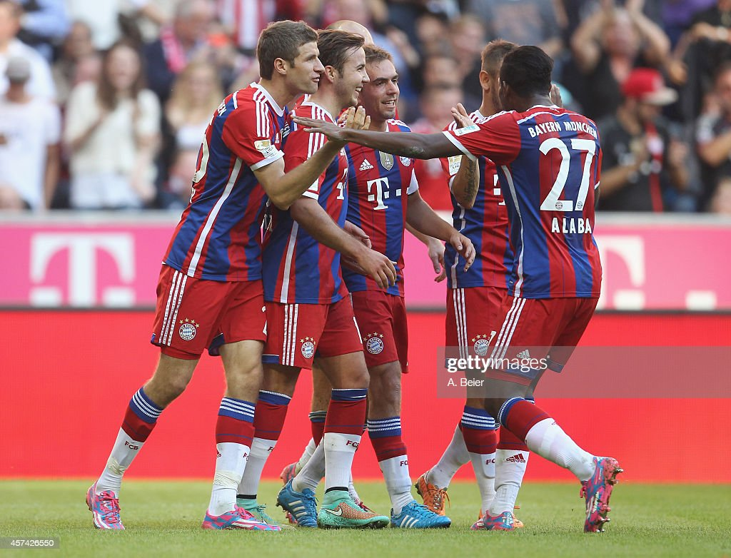 Thomas Mueller, Mario Goetze, Philipp Lahm, Rafinha and David Alaba (L-R) of Bayern Muenchen celebrate their first goal during the Bundesliga match between FC Bayern Muenchen and SV Werder Bremen at Allianz Arena on October 18, 2014 in Munich, Germany.