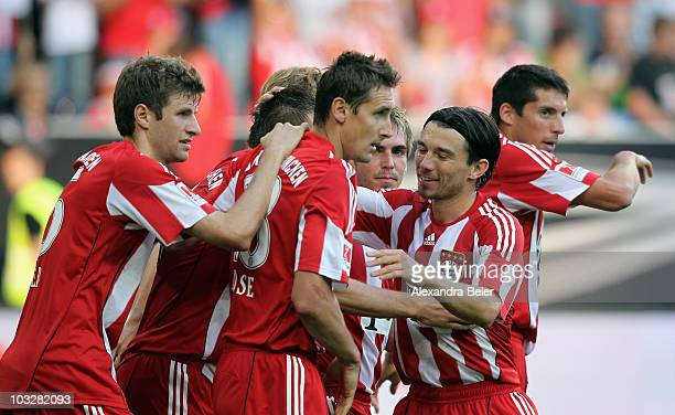 Thomas Mueller Miroslav Klose Philipp Lahm Danijel Pranjic and Jose Ernesto Sosa of Muenchen celebrate their team's second goal during the Supercup...