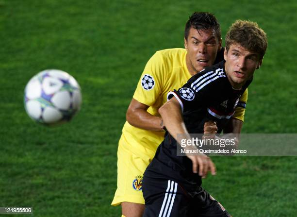 Thomas Mueller of Bayer Muenchen fights for the ball with Jose Catala of Villarreal during the UEFA Champions League group A match between Villarreal...