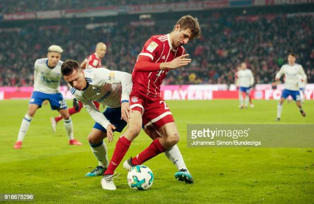 Thomas Mueller of Bayern and Yevhen Konoplyanka of Schalke fight for the ball during the Bundesliga match between FC Bayern Muenchen and FC Schalke...