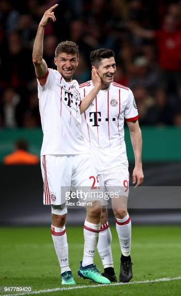 Thomas Mueller of Bayern celebrate with team mate Robert Lewandowski after he scores the 6th goal during the DFB Cup semi final match between Bayer...