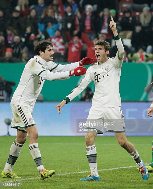Thomas Mueller of Bayern celebrates scoring a goal during the FC Augsburg v Bayern Muenchen DFB Cup match at SGL Arena on December 4 2013 in Augsburg...