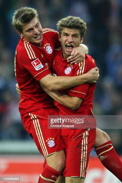 Thomas Mueller of Bayern celebrates the second goal with Toni Kroos during the Bundesliga match between FC Schalke 04 and FC Bayern Muenchen at...
