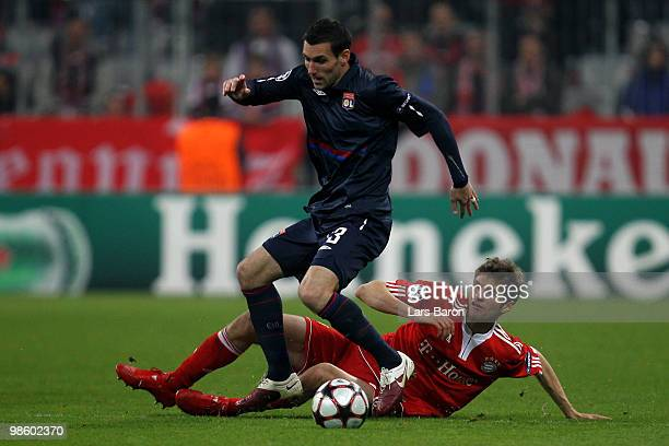 Thomas Mueller of Bayern challenges Anthony Reveillere of Lyon during the UEFA Champions League semi final first leg match between FC Bayern Muenchen...