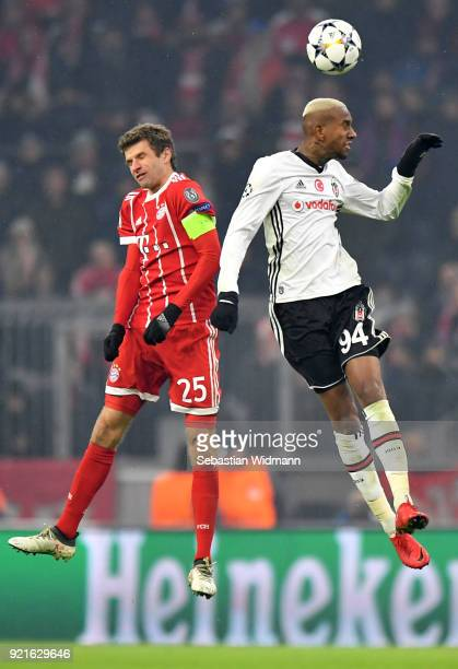 Thomas Mueller of Bayern Muenchen and Anderson Talisca of Besiktas challenge for the ball during the UEFA Champions League Round of 16 First Leg...