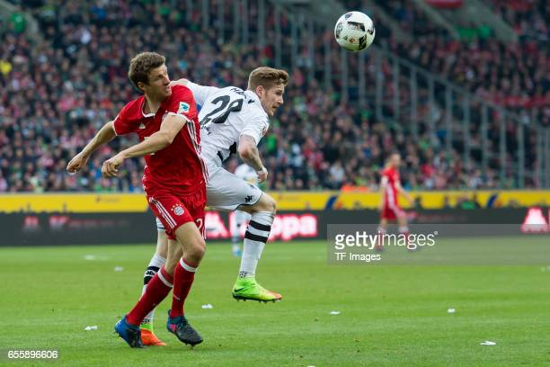 Thomas Mueller of Bayern Muenchen and Andre Hahn of Borussia Moenchengladbach battle for the ball during the Bundesliga match between Borussia...