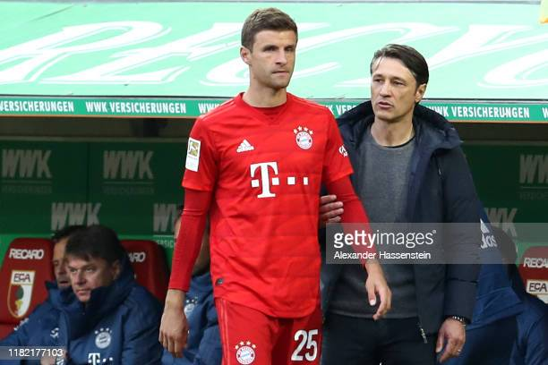 Thomas Mueller of Bayern Muenchen and head coach Niko Kovac during his substitution the Bundesliga match between FC Augsburg and FC Bayern Muenchen...