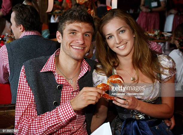 Thomas Mueller of Bayern Muenchen and his girlfried Lisa attend the Oktoberfest beer festival at the Kaefer Wiesnschaenke tent on October 4 2009 in...