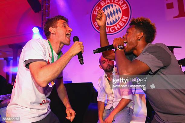 Thomas Mueller of Bayern Muenchen and his team mate David Alaba performes with the band `Seiler und Speer` during the FC Bayern Muenchen champions...