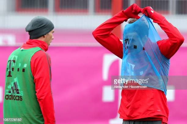 Thomas Mueller of Bayern Muenchen and his team mate Leon Goretzka during a training session at Saebener Strasse training ground on November 4 2018 in...