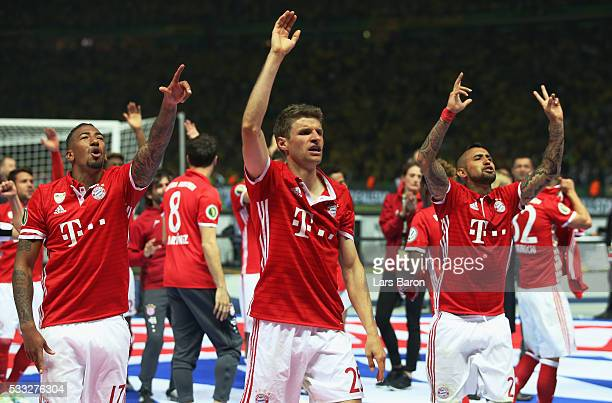Thomas Mueller of Bayern Muenchen and his team mates Arturo Vidal after winning the DFB Cup Final in a penalty shootout against Borussia Dortmund at...