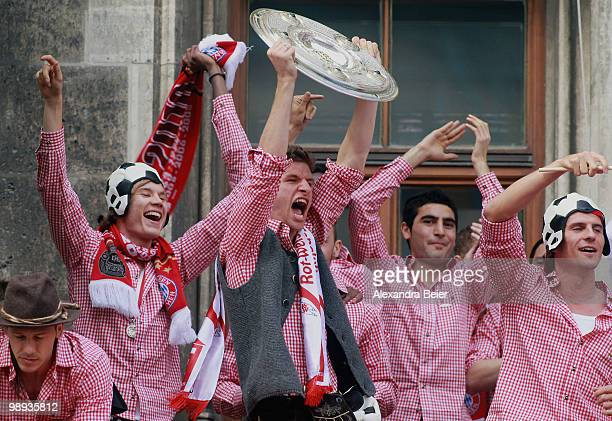 Thomas Mueller of Bayern Muenchen and his team mates celebrate the German championship title on the balcony of the town hall on May 9 2010 in Munich...