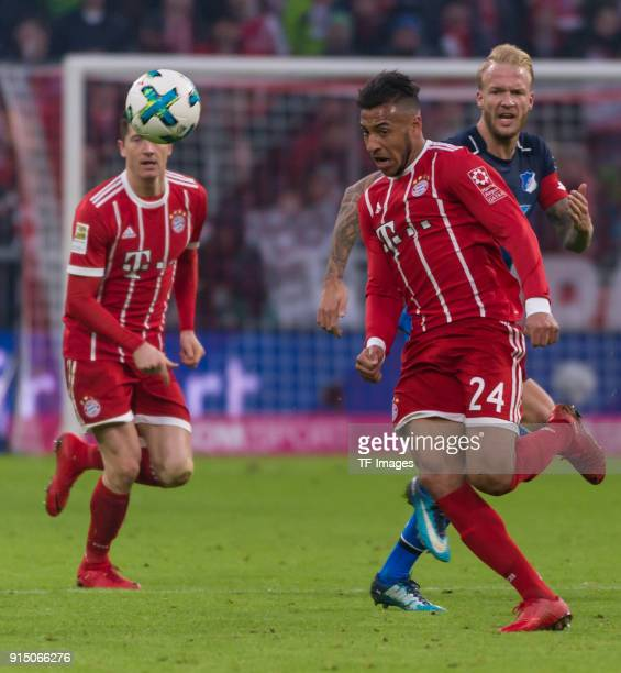 Thomas Mueller of Bayern Muenchen and Kevin Vogt of Hoffenheim battle for the ball during the Bundesliga match between FC Bayern Muenchen and TSG...