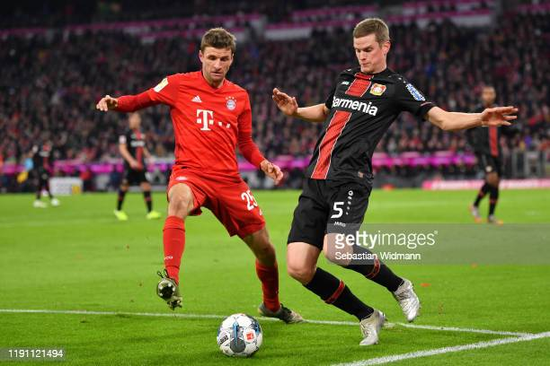 Thomas Mueller of Bayern Muenchen and Sven Bender of Leverkusen compete for the ball during the Bundesliga match between FC Bayern Muenchen and Bayer...