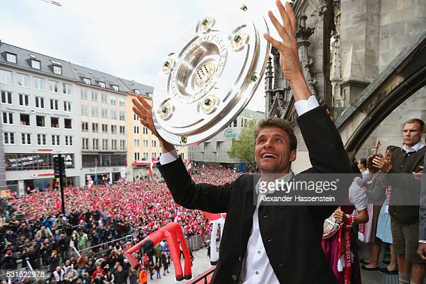 Thomas Mueller of Bayern Muenchen celebrate winning the German Championship title on the town hall balcony at Marienplatz on May 15 2016 in Munich...