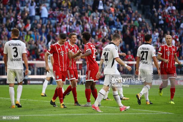 Thomas Mueller of Bayern Muenchen celebrates after Julian Schusterof Freiburg scored an own goal to make it 10 for Munich during the Bundesliga...