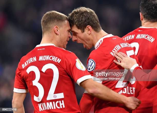 Thomas Mueller of Bayern Muenchen celebrates after scoring his sides second goal with Joshua Kimmich of Bayern Muenchen during the DFB Cup match...