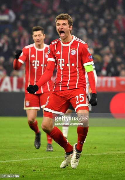 Thomas Mueller of Bayern Muenchen celebrates after scoring his sides third goal during the UEFA Champions League Round of 16 First Leg match between...