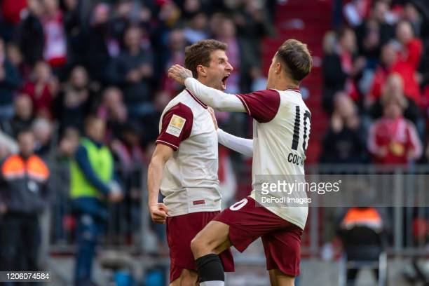Thomas Mueller of Bayern Muenchen celebrates after scoring his team's 1:0 goal during the Bundesliga match between FC Bayern Muenchen and FC Augsburg...