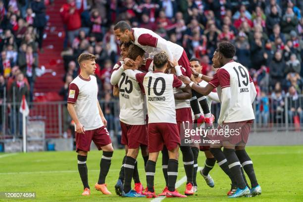 Thomas Mueller of Bayern Muenchen celebrates after scoring his team's 1:0 goal with his team mates during the Bundesliga match between FC Bayern...