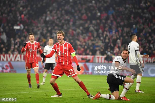 Thomas Mueller of Bayern Muenchen celebrates after scoring his teams third goal during the UEFA Champions League Round of 16 First Leg match between...