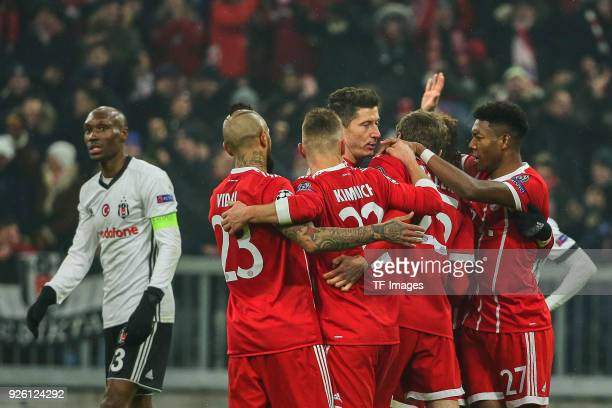 Thomas Mueller of Bayern Muenchen celebrates after scoring his team`s first goal with team mates during the UEFA Champions League Round of 16 First...