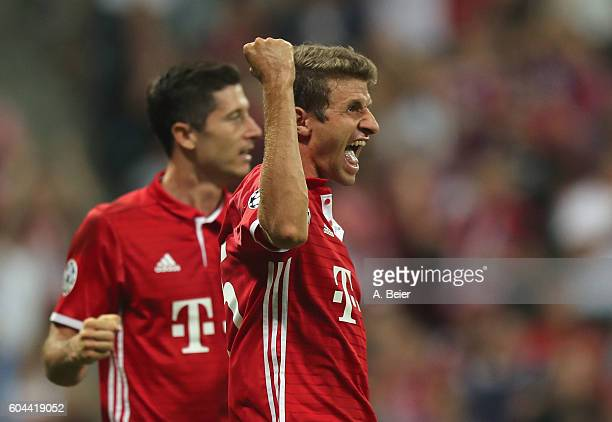 Thomas Mueller of Bayern Muenchen celebrates his first goal with teammate Robert Lewandowski during the UEFA Champions League match between FC Bayern...