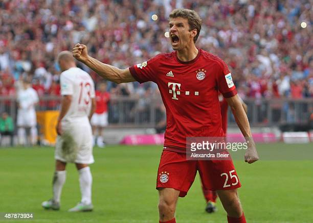 Thomas Mueller of Bayern Muenchen celebrates his penalty goal during the Bundesliga match between FC Bayern Muenchen and FC Augsburg at Allianz Arena...