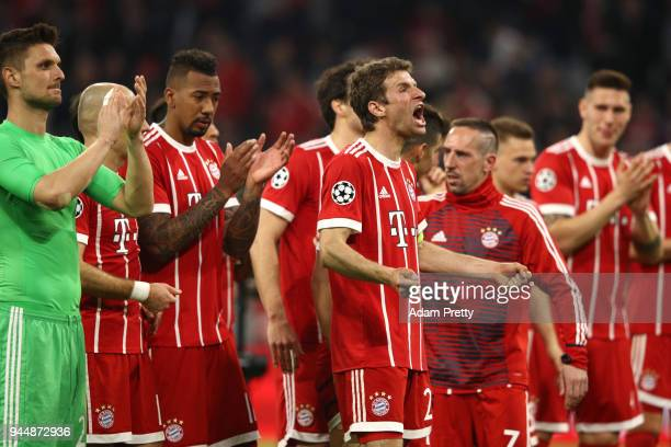Thomas Mueller of Bayern Muenchen celebrates his sides victory with his teammates after the UEFA Champions League Quarter Final Second Leg match...