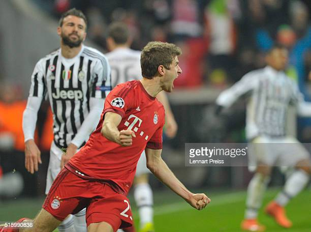 Thomas Mueller of Bayern Muenchen celebrates his team's second goal during the UEFA Champions League Round of 16 second leg match between FC Bayern...