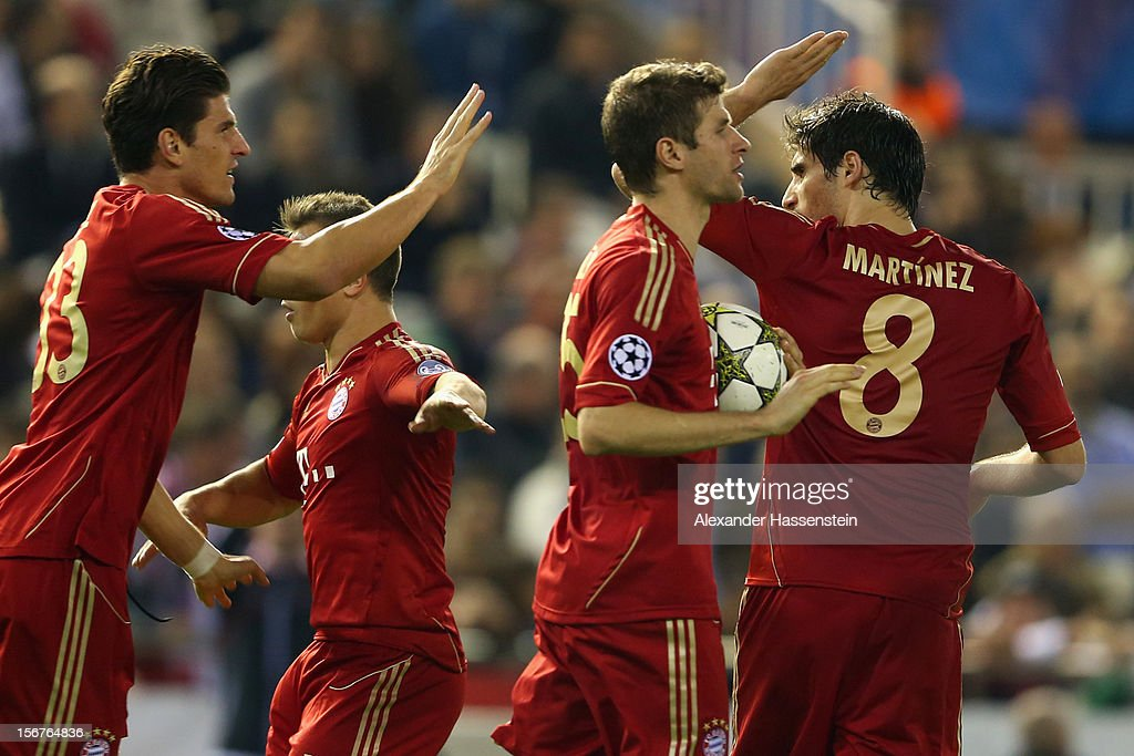 Thomas Mueller (2nd R) of Bayern Muenchen celebrates scoring his first team goal with his team mates during the UEFA Champions League group F match between Valencia FC and FC Bayern Muenchen at Estadio Mestalla on November 20, 2012 in Valencia, Spain.