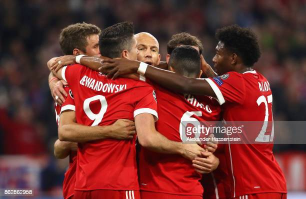Thomas Mueller of Bayern Muenchen celebrates scoring his sides first goal with his Bayern Muenchen team mates during the UEFA Champions League group...