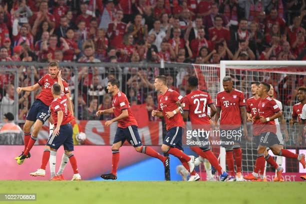 Thomas Mueller of Bayern Muenchen celebrates scoring his teams first goal during the Bundesliga match between FC Bayern Muenchen and TSG 1899...