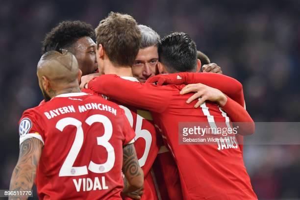 Thomas Mueller of Bayern Muenchen celebrates scoring his teams second goal with teammates Arturo Vidal David Alaba Robert Lewandowski and James...
