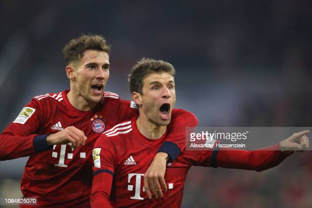 Thomas Mueller of Bayern Muenchen celebrates scoring the second team goal with his team mate Leon Goretzka during the Bundesliga match between FC...
