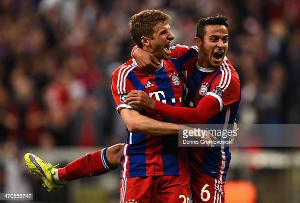 Thomas Mueller of Bayern Muenchen celebrates scoring their fourth goal with Thiago Alcantara of Bayern Muenchen during the UEFA Champions League...
