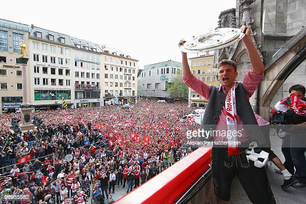 Thomas Mueller of Bayern Muenchen celebrates the German championship title on the balcony of the town hall on May 9 2010 in Munich Germany