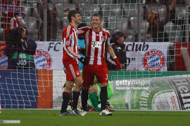 Thomas Mueller of Bayern Muenchen celebrates the second team goal with his team mate Bastian Schweinsteiger during the UEFA Champions League group E...