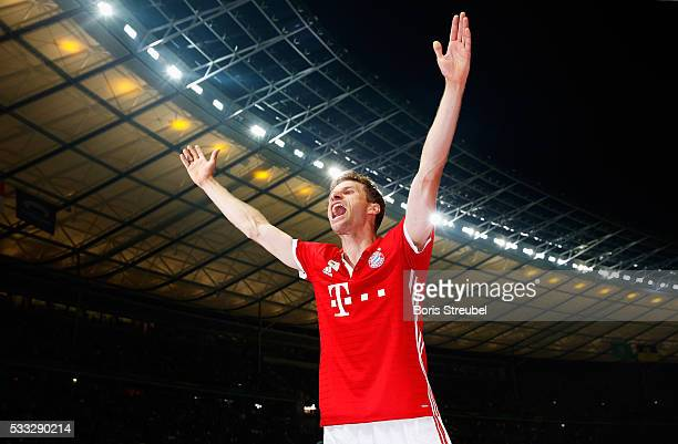 Thomas Mueller of Bayern Muenchen celebrates victory after the DFB Cup final match between FC Bayern Muenchen and Borussia Dortmund at Olympiastadion...