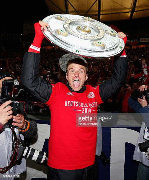 Thomas Mueller of Bayern Muenchen celebrates winning the German Championship after the the Bundesliga match between Hertha BSC and FC Bayern Muenchen...