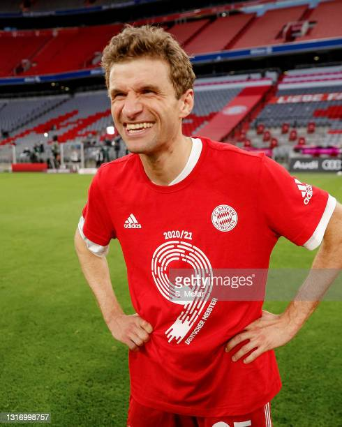 Thomas Mueller of Bayern Muenchen celebrates winning the league title after the Bundesliga match between FC Bayern Muenchen and Borussia...