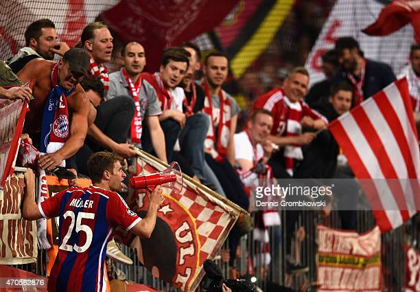 Thomas Mueller of Bayern Muenchen celebrates with fans after victory in the UEFA Champions League Quarter Final Second Leg match between FC Bayern...