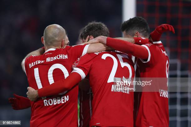 Thomas Mueller of Bayern Muenchen celebrates with his team after he scored a goal to make it 21 during the Bundesliga match between FC Bayern...